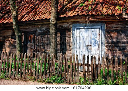 Abandoned wooden ramshackle among trees