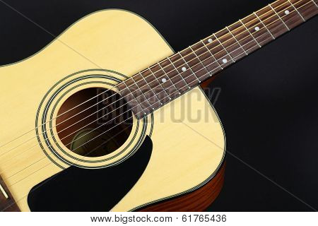 Six-string acoustic guitar closeup
