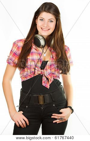 beautiful girl in headsets in the studio of the audio recording