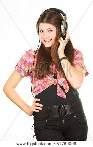 a beautiful girl listens music in headsets
