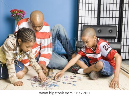 Family Doing A Puzzle