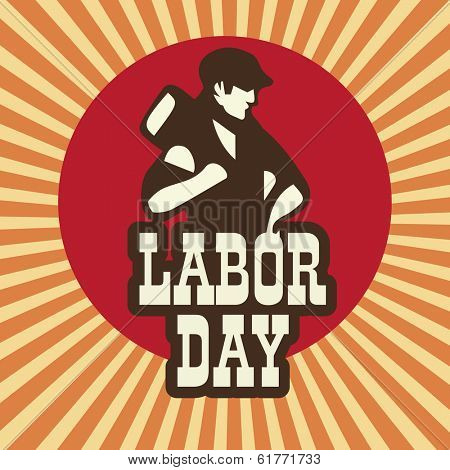 Happy Labor Day background with young worker holding a hammer on vintage background.