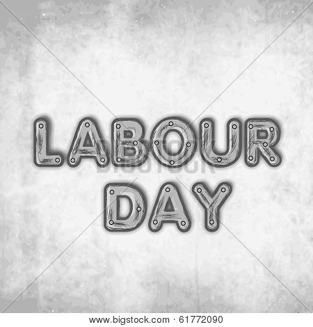 Labour Day concept with stylish text on grungy grey background, can be use as flyer, poster or banner.