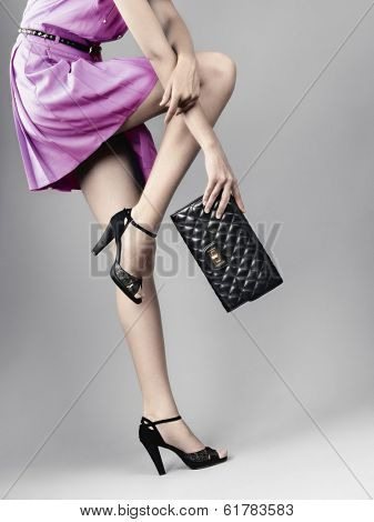 woman legs in black high heels shoes