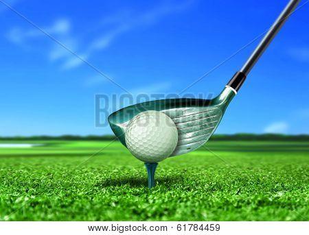Golf Ball On Tee With Blue Sky