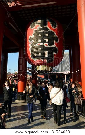 Tokyo, Japan - Nov 21: Imposing Buddhist Structure Features A Massive Paper Lantern Painted In Vivid