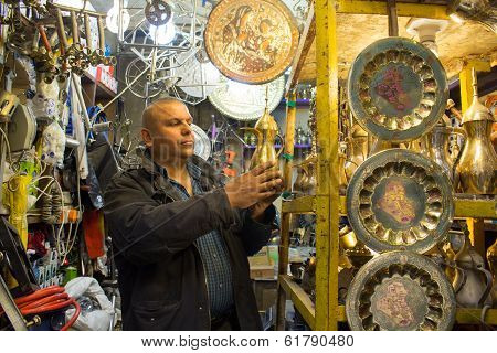 Iraqi man shopping in a market beeps