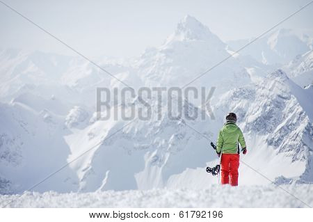 Female snowboarder at the mountains