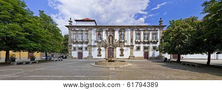 Guimaraes, Portugal - April 25, 2013: Guimaraes City-Hall in the former Santa Clara nunnery building. Unesco World Heritage site.