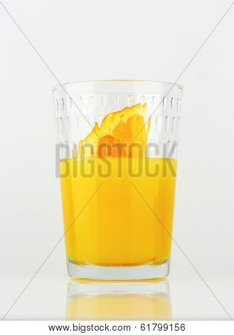 orange juice with piece of fresh orange, in the glass
