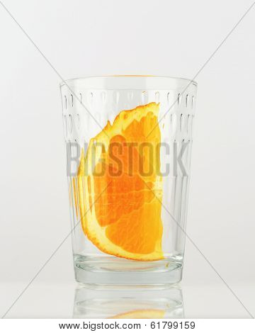 piece of orange in the glass