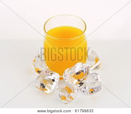cold juice in the glass with ice cubes