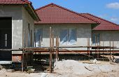 stock photo of scaffolding  - Building a house private project under construction scaffolding - JPG