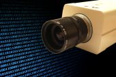 stock photo of voyeur  - A security camera in front of a binary blue background - JPG