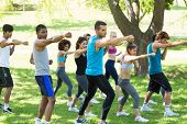 stock photo of boxing day  - Group of multiethnic friends exercising in park - JPG
