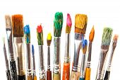 picture of bristle brush  - Paint brushes and oil paints in the composition on the table - JPG