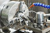 foto of turn-up  - Close up machining tool drill during metal cutting process boring a hole - JPG
