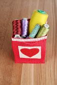 pic of lurex  - Colorful bobbins of thread  in bag - JPG