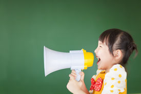 pic of shout  - happy kid shouts something into the megaphone with board - JPG