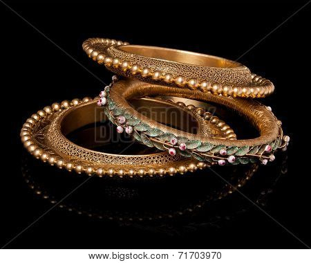 Close up of designer golden bangles