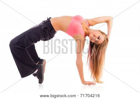 Young female breakdance dancer isolated on white background.