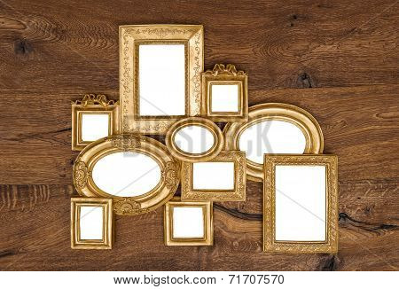 Antique Golden Framework Over Rustic Wooden Wall