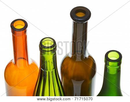 Open Bottlenecks Of Colored Wine Bottles Close Up