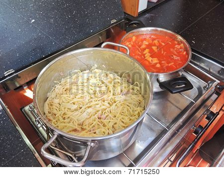 Cooking Pasta With Sausage And Meat Gravy On Stove
