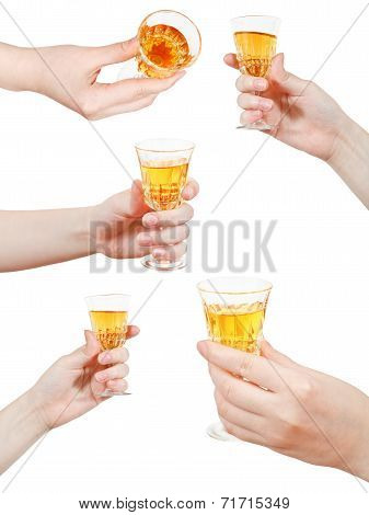 Set Of Hand Holds Little Glass Of Dessert Wine