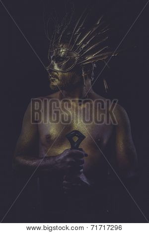 masculine, golden bodypaint, man with gold helmet, ancient warrior deity