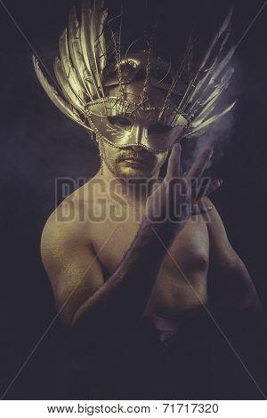 golden bodypaint, man with gold helmet, ancient warrior deity