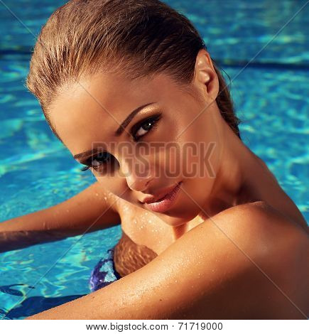 Portrait Of Beautiful Girl With Blond Hair Posing In Swimming Pool
