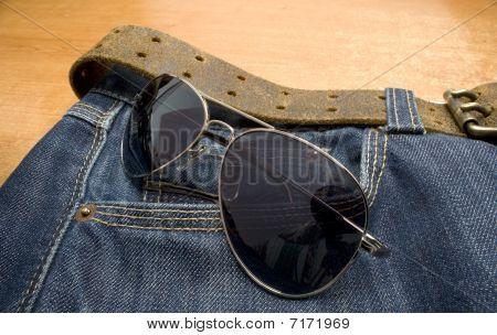 glasses on jeans
