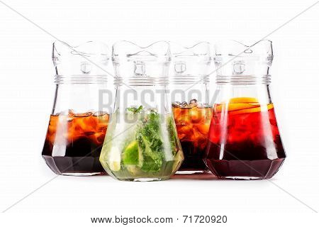 Four carafe pitcher with colorful cocktails