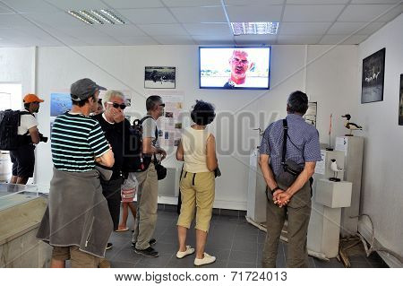 Tourists Watching A Video Saline Aigues-mortes