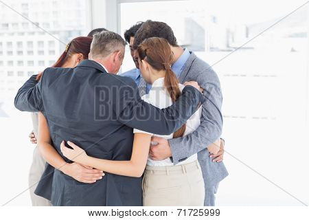 Business team all huddled together in a circle