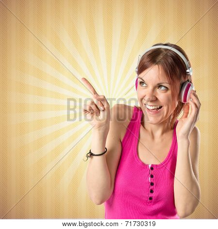 Young Girl Listening Music Over Ocher Background