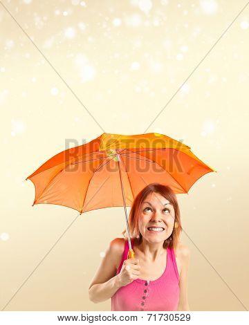 Girl Holding An Umbrella Over Ocher Background