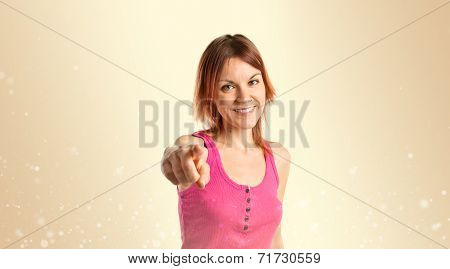 Young Girl Pointing Over Ocher Background