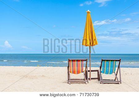 Pair Of Beach Chair With Sun Umbrella On Beautiful Beach.
