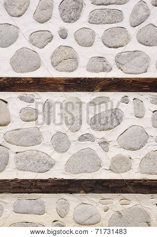 Stone Wall With Two Wooden Beams