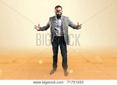Man With Toxic Mask Over Ocher Background