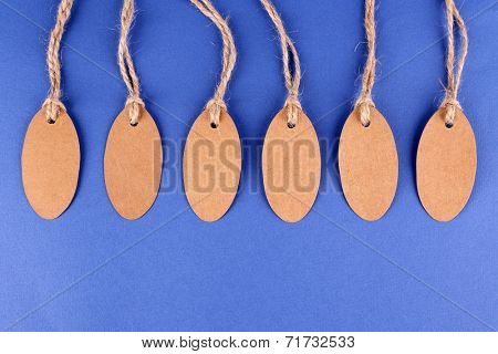 Brown tags on colorful background