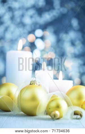 Christmas light blue background with baubles candles and ribbons - vertical