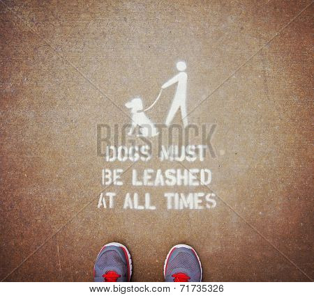 Dogs on leash sign in public park