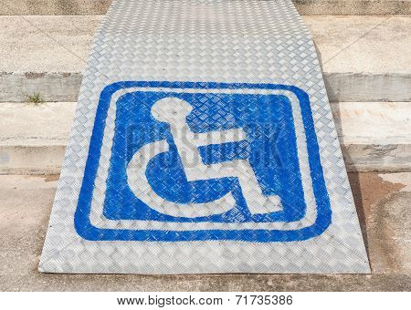 The Blue Sign Indicating Wheelchair Usage On Ramp For Disabled People.