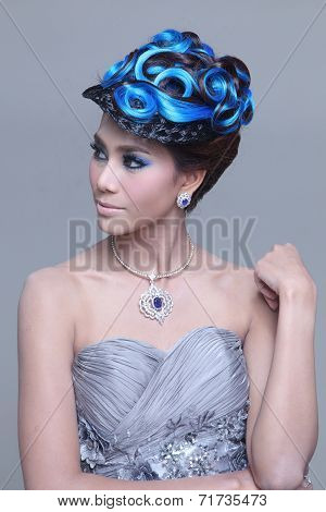 elegant fashion brunette Thai woman posing with creative chignon hair-style