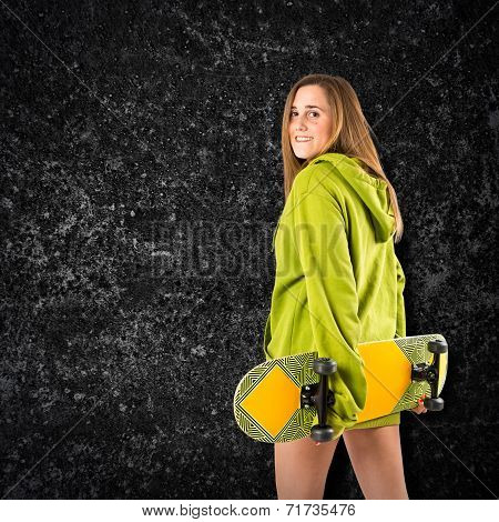 Skater With Green Sweatshirt Over Black Background