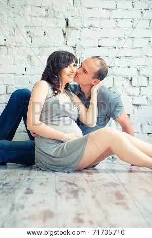 Husband Kisses His Pregnant Wife