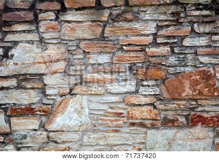 Aged stone wall by the time